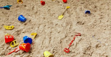 Empty Sandbox with toys