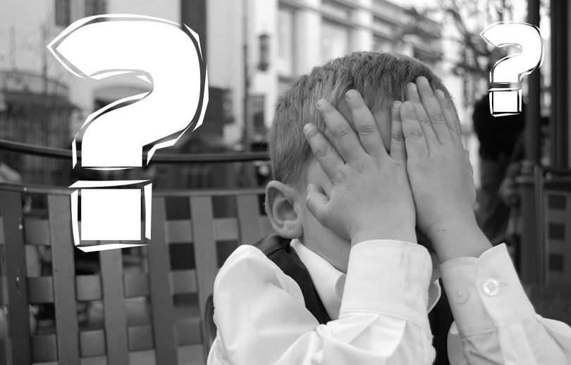 Child and question marks