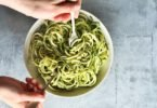 Mixing zucchini noodles
